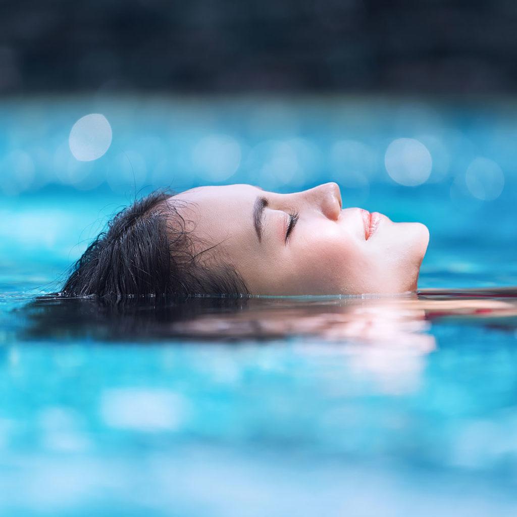 Resident enjoying swimming pool